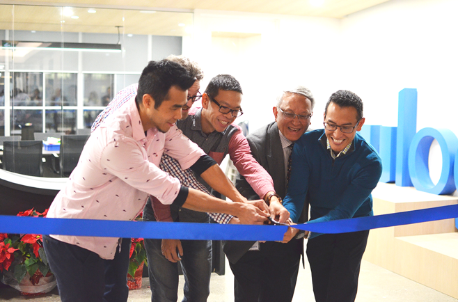 OUR FOUNDERS CUT THE RIBBON TO OUR NEW OFFICE